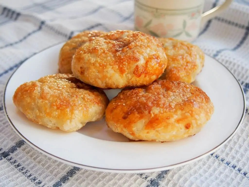 plate of Eccles cakes - crisp currant filled pastries