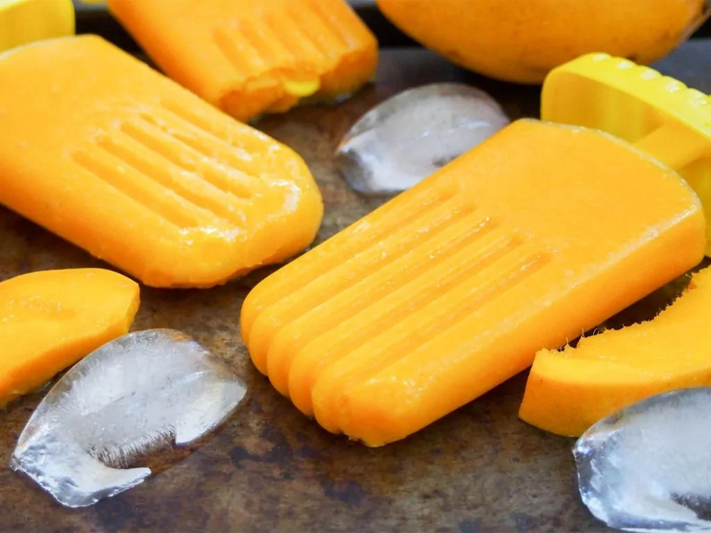 mango palatas (ice pops) on tray with ice to side