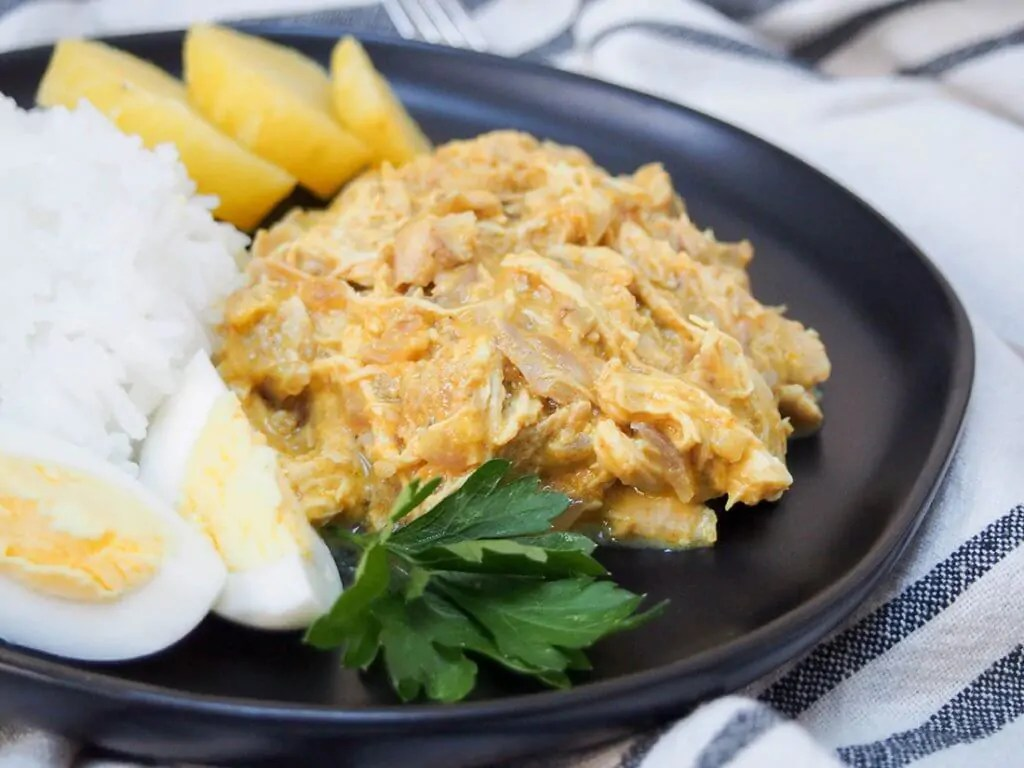 Aji de gallina (Peruvian chicken) close up on plate