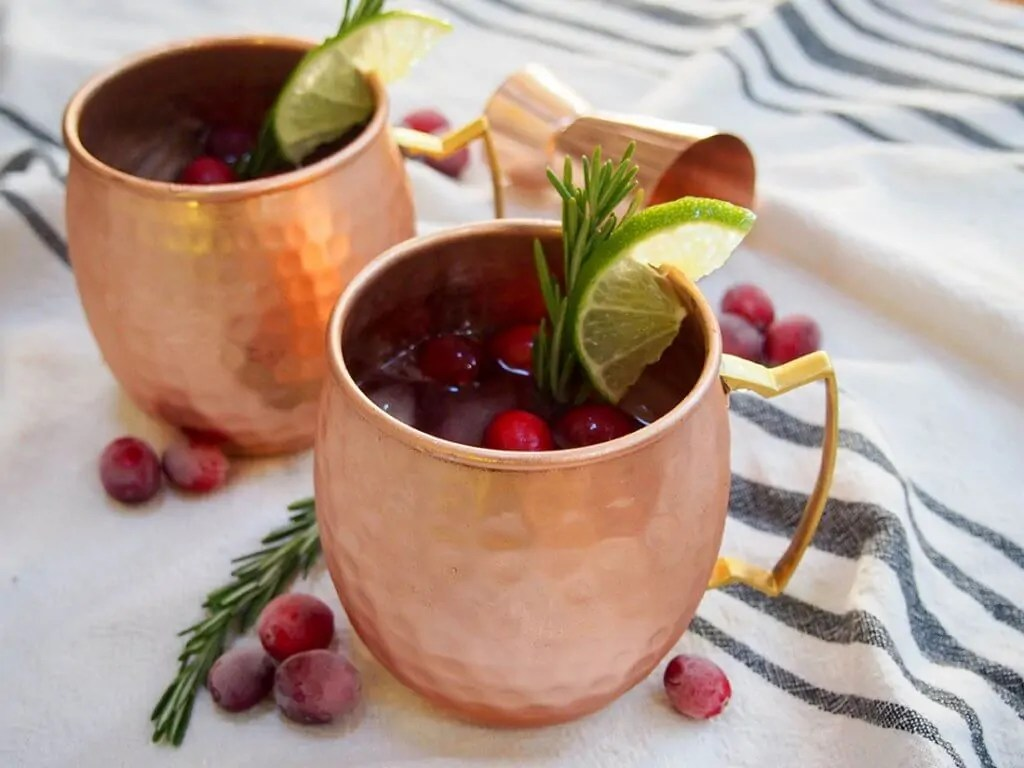 cranberry Moscow mule in copper mugs