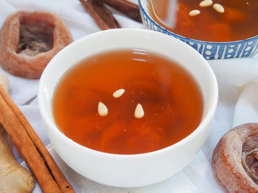 Sujeonggwa (Korean ginger cinnamon punch) in bowl
