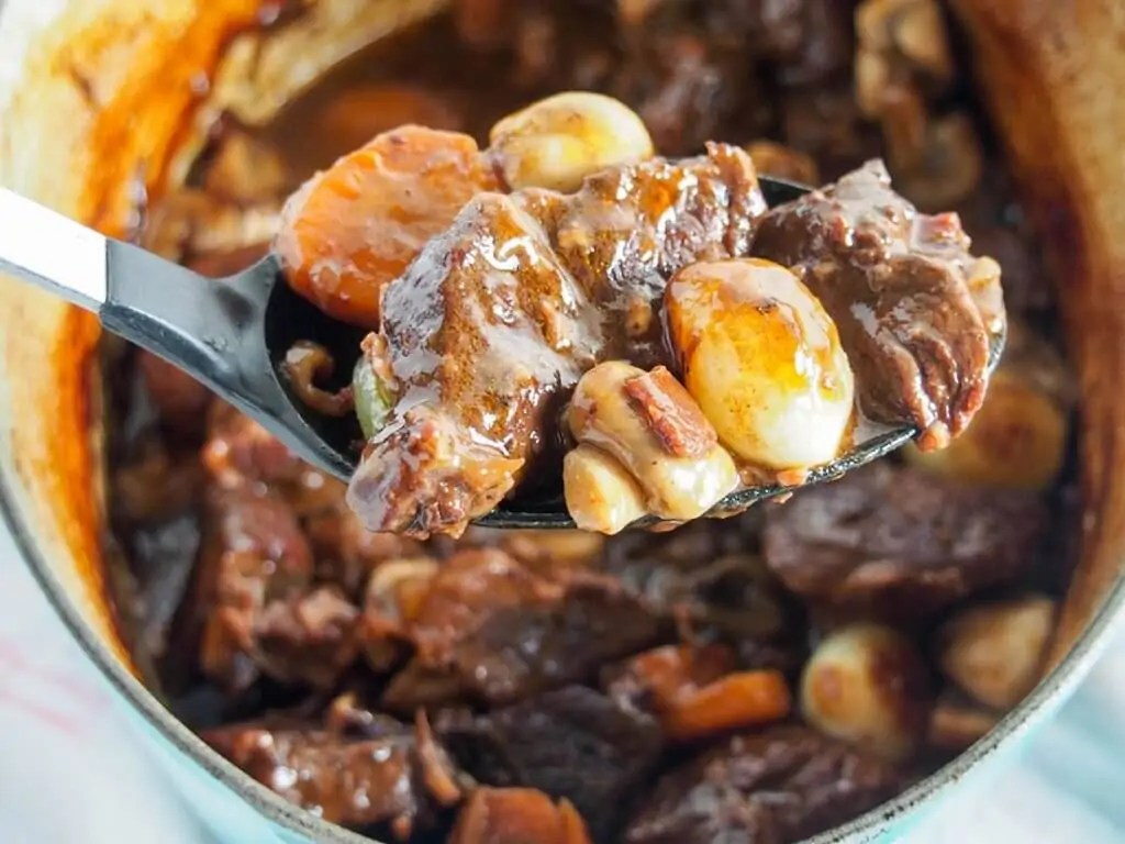 Beef bourguignon with spoonful held in front