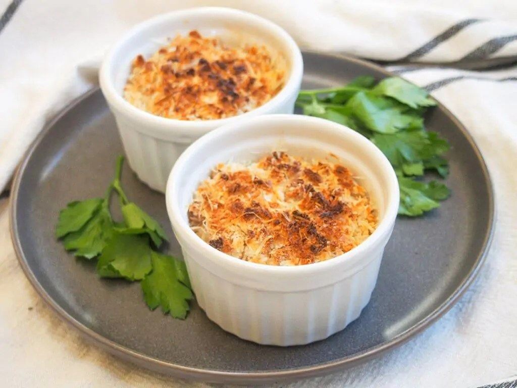 two dishes of Coquille St Jacques (scallop gratin)
