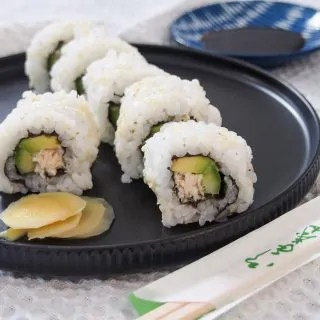 California roll with side of pickled ginger and soy behind