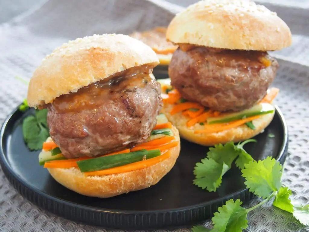 chicken satay burgers on plate