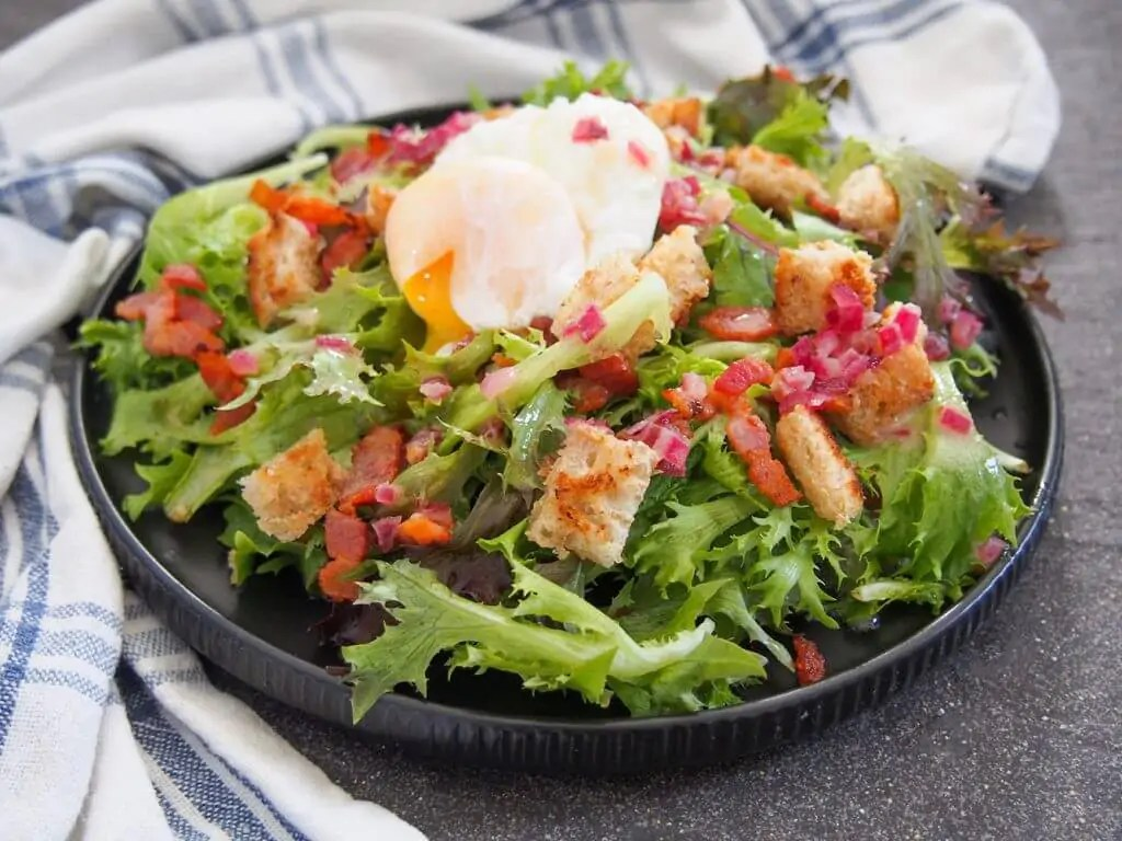 salade Lyonnaise - a simple green salad with bacon and egg on top