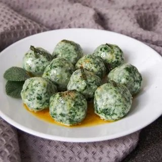Ricotta and spinach gnudi on plate with sage browned butter