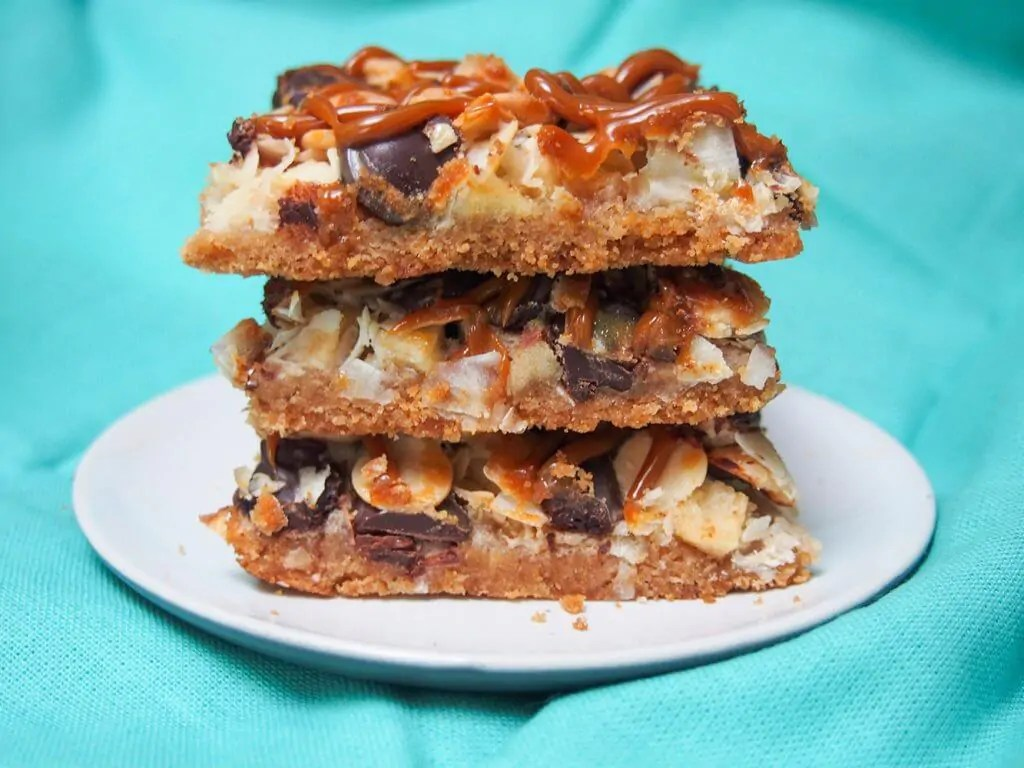 caramel apple magic bars in stack on plate