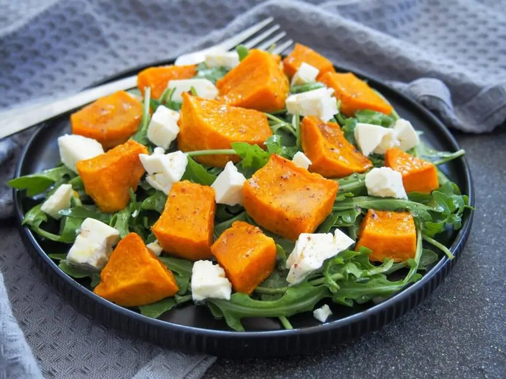 plate of roasted kabocha squash salad with feta