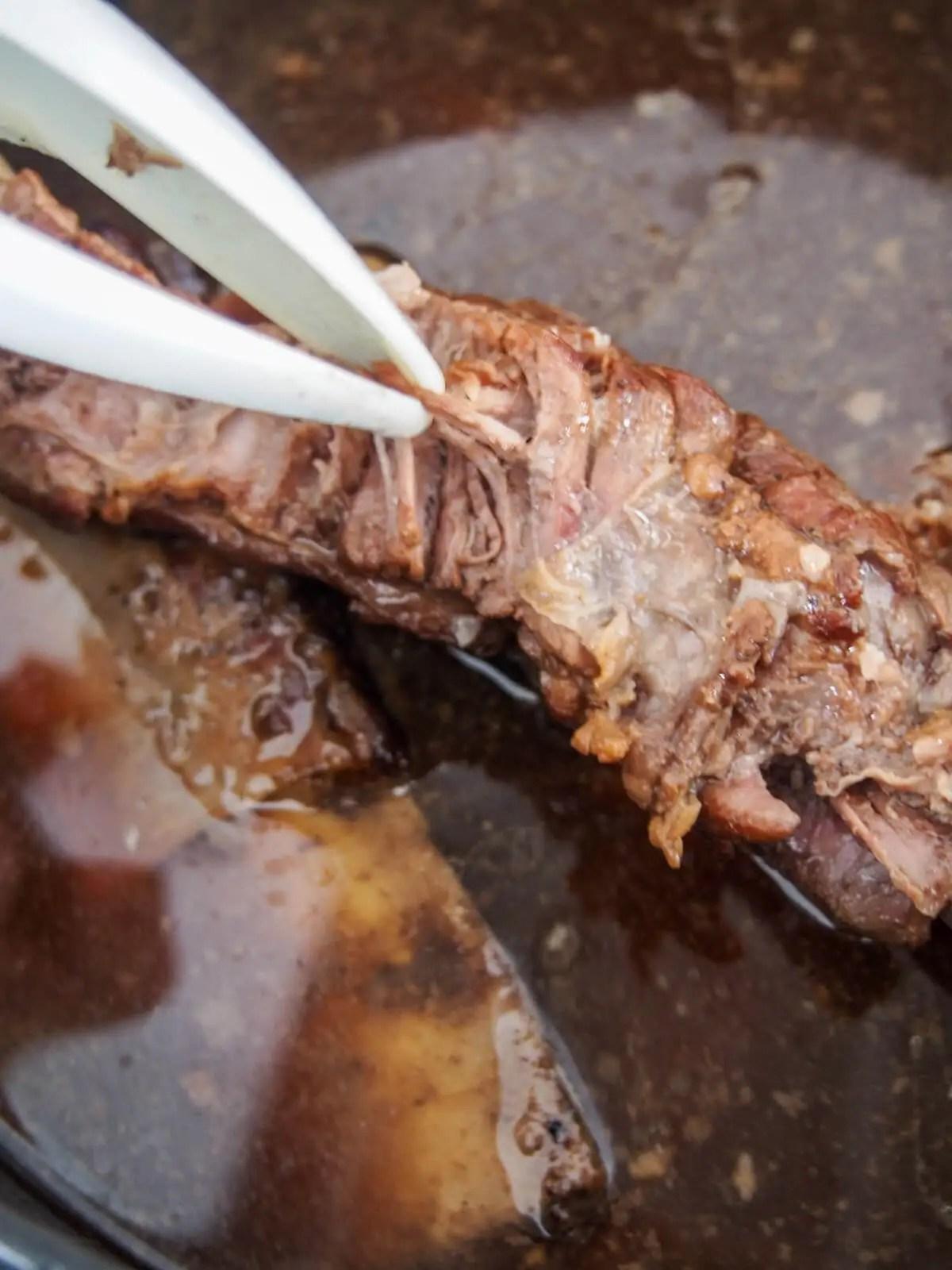 shredding short rib meat from bones
