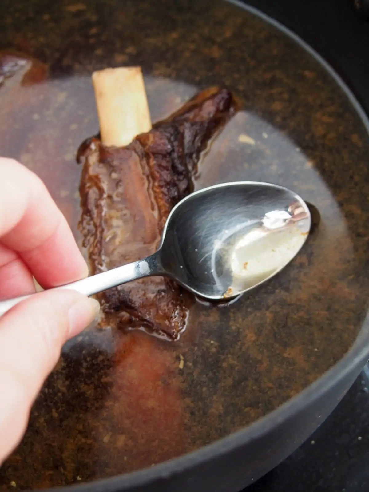 skimming fat from short rib broth