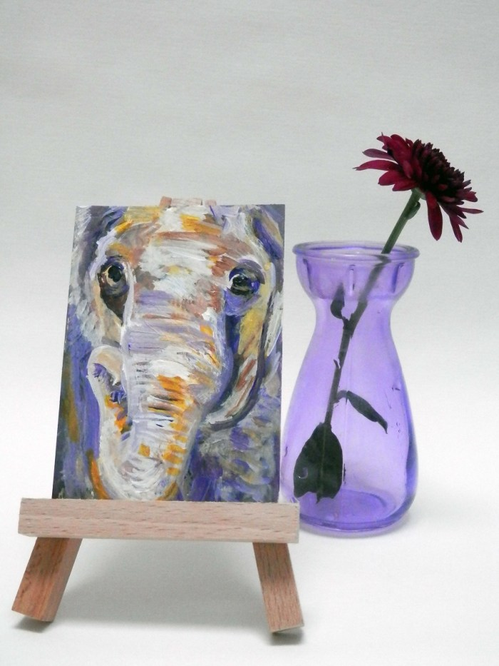 purple and yellow elephant ACAO, miniature purple elephant, purple elephant artist trading card, purple and orange elephant art, golden yellow art
