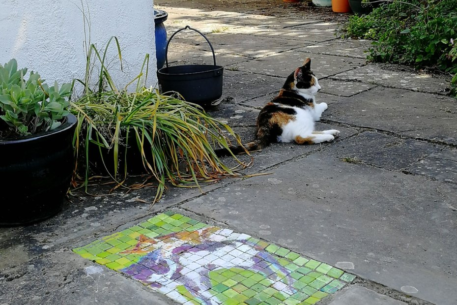 Cats mosaic garden design feature with cat next to it