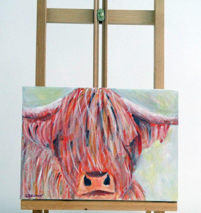 highland cow canvas on easel