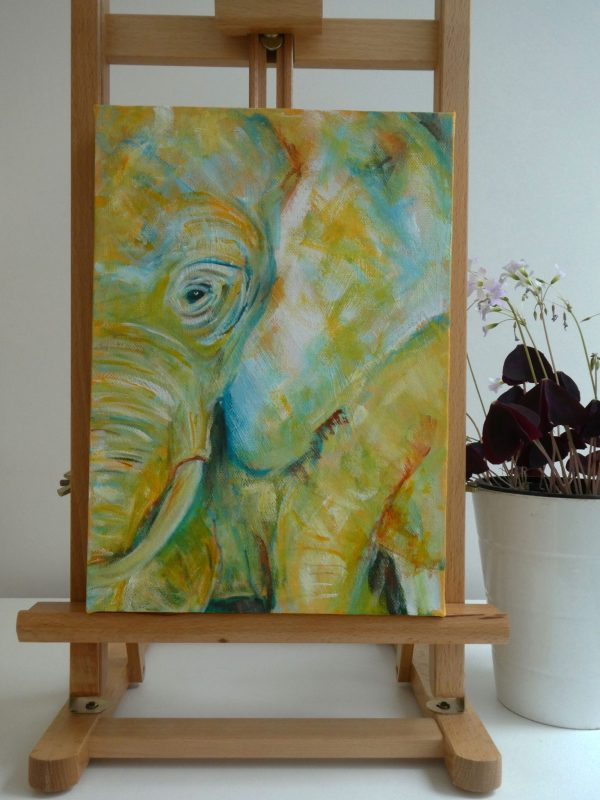 Yellow unframed elephant picture on easel