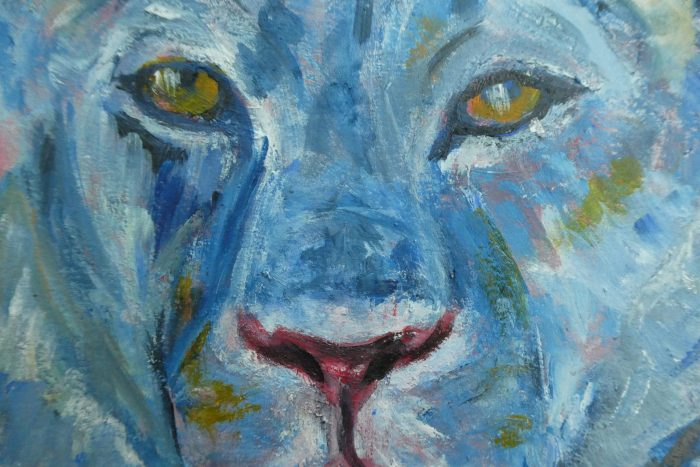 Close up of blue lion painting