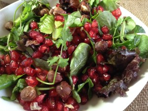 Herb salad with roasted hazelnuts and pomegranits