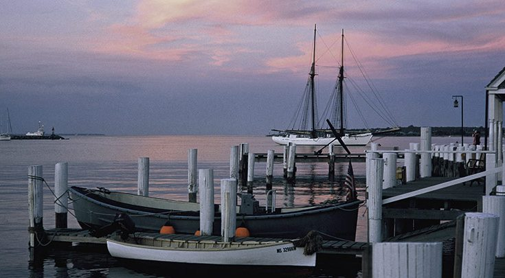 Martha's Vineyard harbor at sunset docks and boat