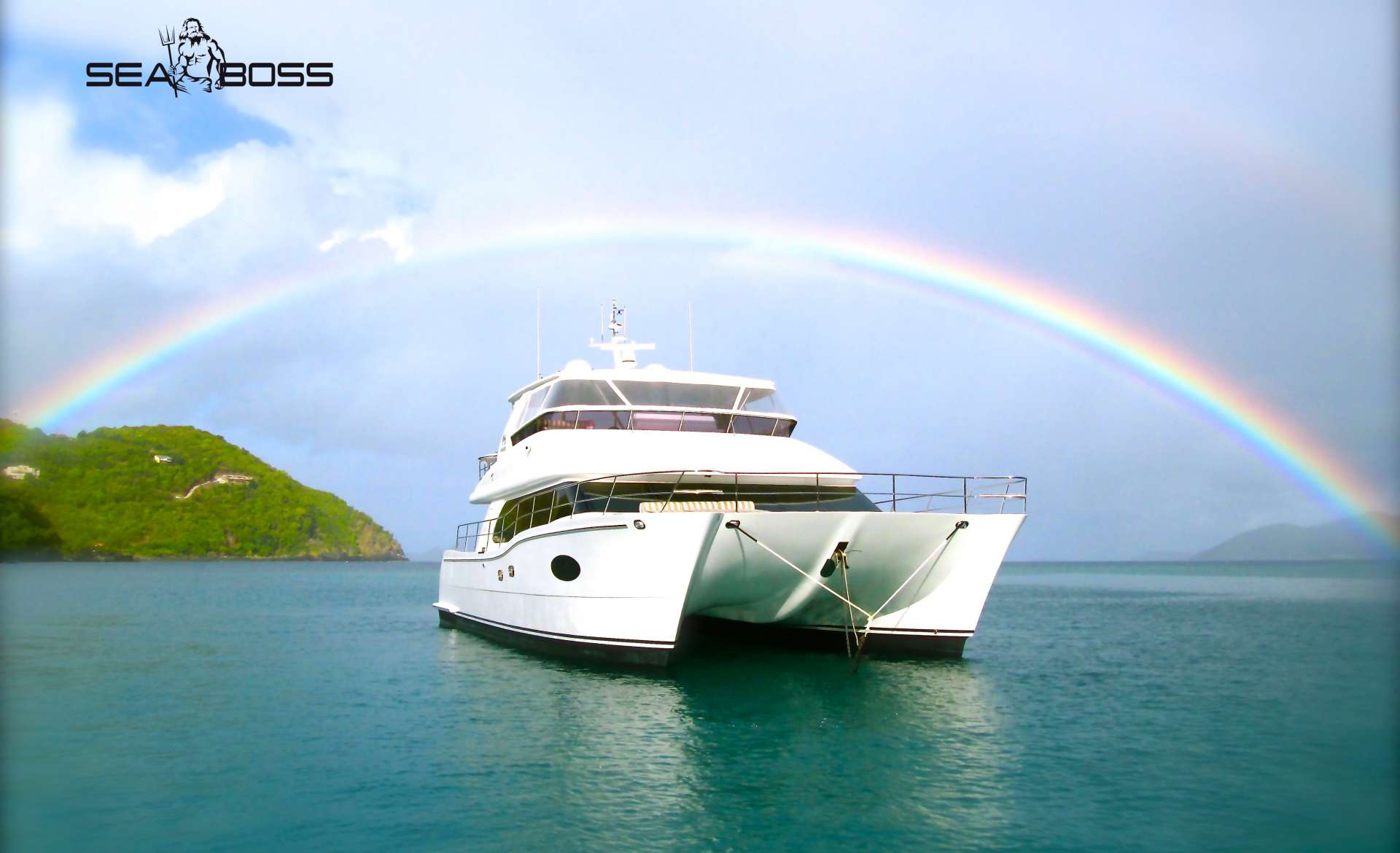 Rainbow over sailing catamaran SEA BOSS Caribbean Yachting Comeback