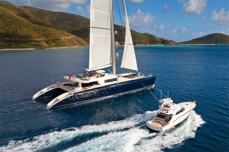 Tender alongside 145ft HEMISPHERE - the world's largest sailing catamaran