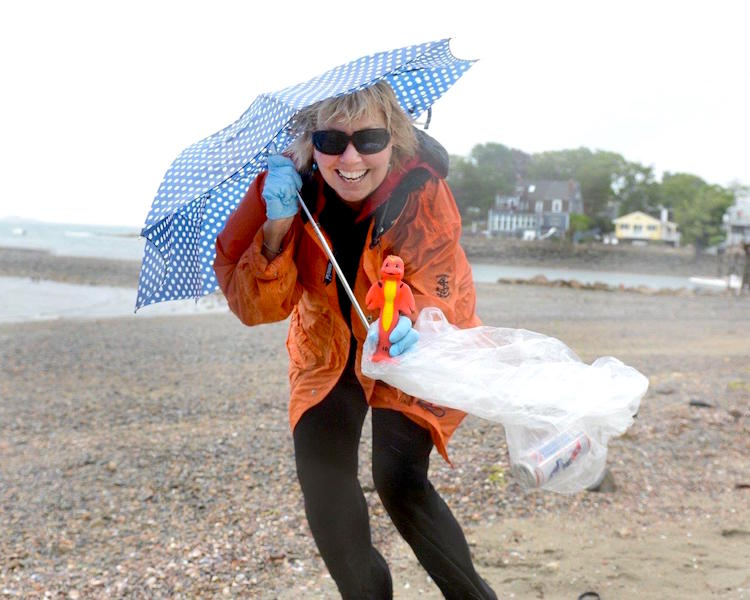 Carol Kent cleaning up Preston Beach in Marblehead, Massachusetts