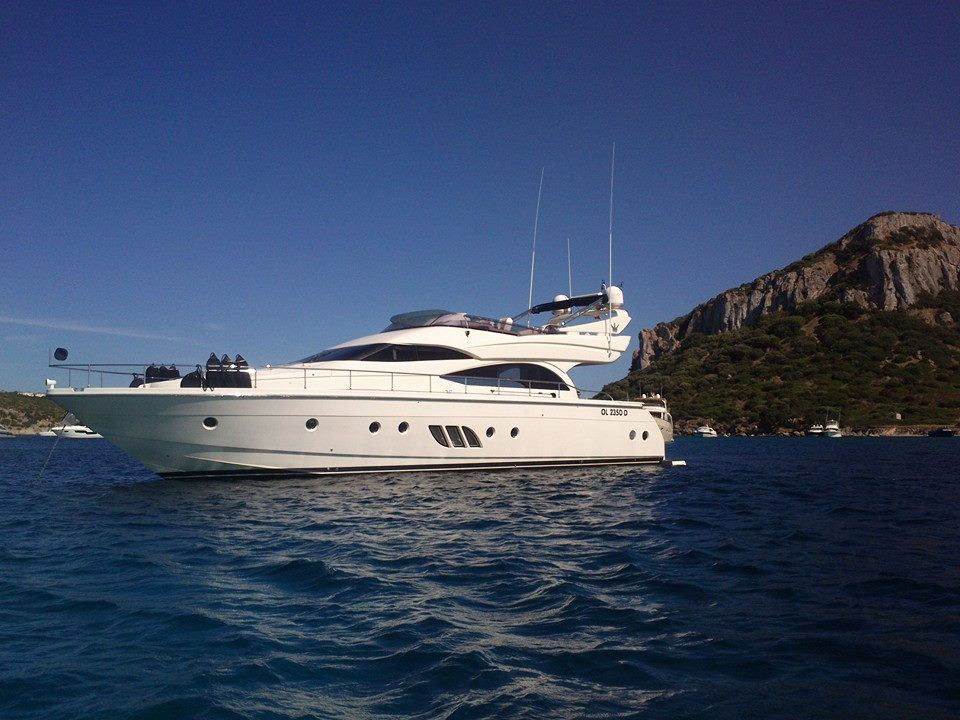 Main shot of 62ft Dominator motor yacht JACO anchored off the Mediterranean coast