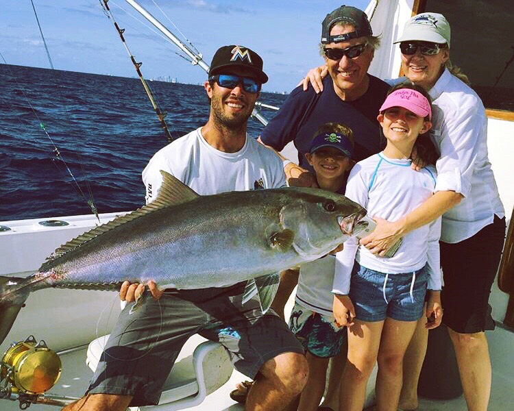 Family and MAVERICK captain with big sport fish catch