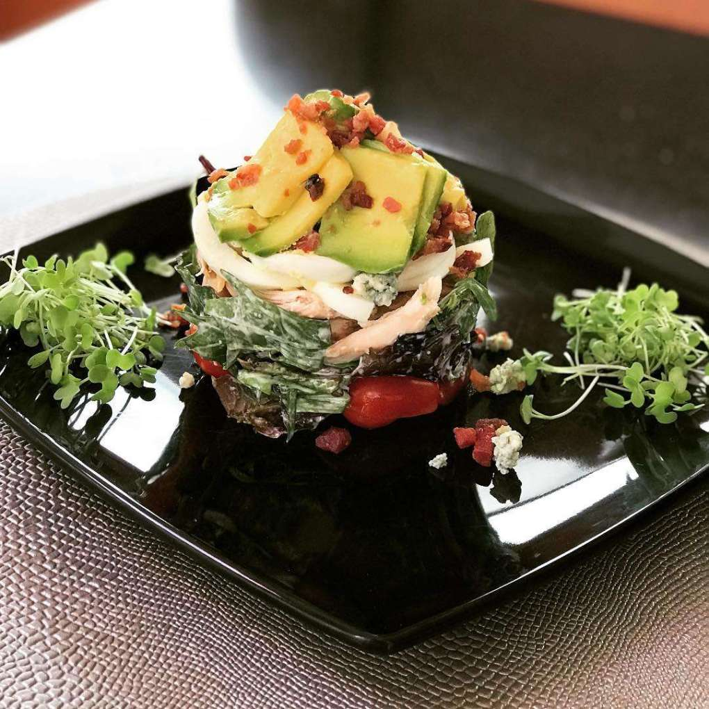 Chef Jen's Grilled Jumbo Shrimp with Avocado & Pineapple Salsa Tower Salad is a favorite dish on her 46ft catamaran