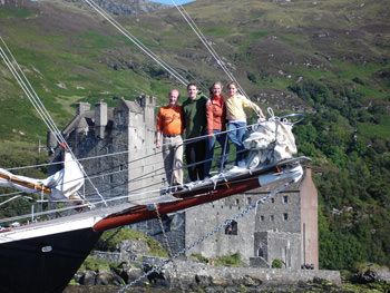 Passengers on the 72ft schooner BONNIE LYNN in Scotland passing a castle