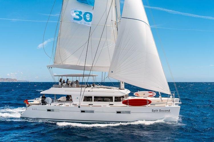 Profile of Twin Flame 62ft Lagoon sailing yacht catamaran at sea in The Bahamas
