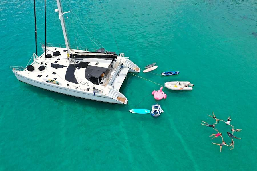 Lolalita with toys and floating friends and family circle 65ft Sailing catamaran