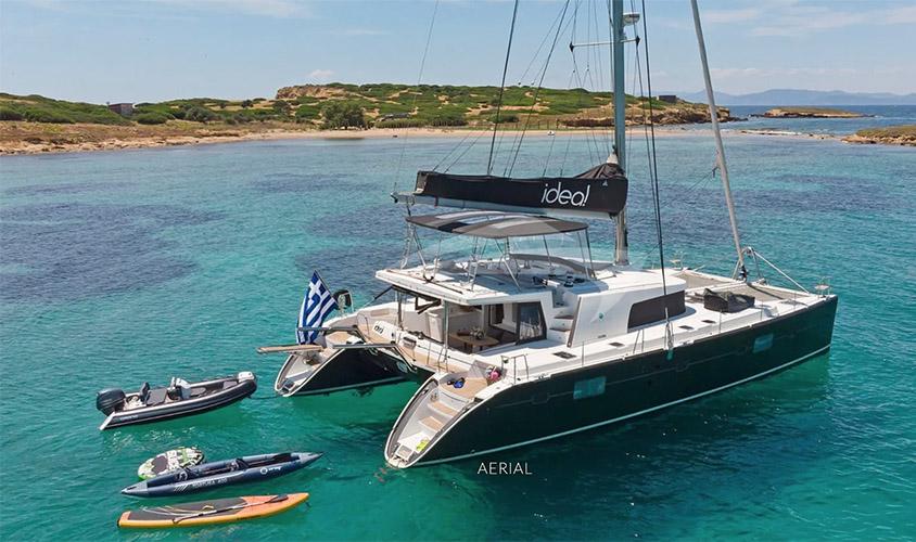 Stern shot of 50ft Lagoon sailing catamaran IDEA at anchor with toys and tenders
