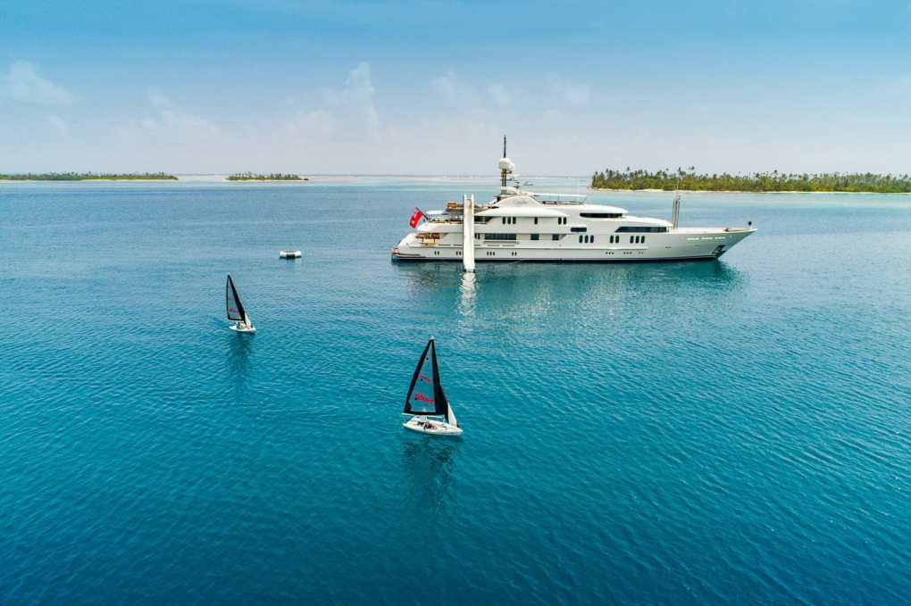 Sailboats and slides off 202ft Amels superyacht CALYPSO