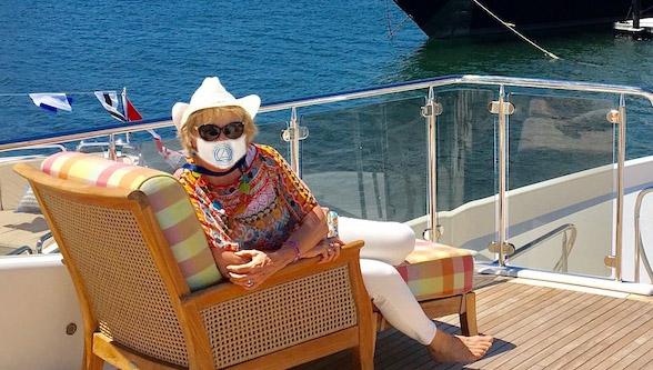 Carol Kent yacht charter broker wearing a COVID mask on deck of yacht in Newport, Rhode Island