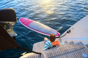 A standup paddleboard awaits a STOP WORK ORDER guest off the aft deck in St. Croix, USVI