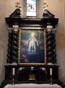 St Bernard chaining the devil