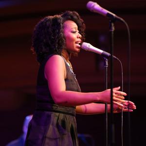 photo of Alicia Olatuja on stage singing