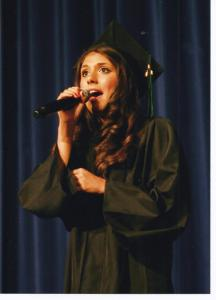 Elise performing at graduation