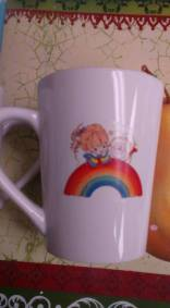 little girl with rainbow cup decal