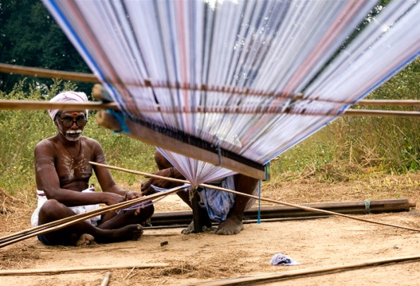 A weaver preparing the warp in a village near Kanchipuram, India.