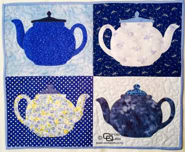 Blue teapots quilted with copyright Carols Quilts
