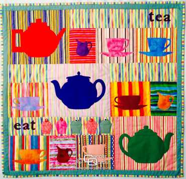 Quilted colourful teacups with copyright Carols Quilts