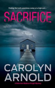 Sacrifice by Carolyn Arnold, a boathouse at the end of a dock sitting in a frozen river under a cloudy sky