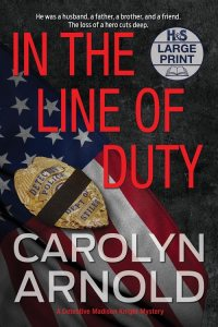In the Line of Duty Large Print Edition by Carolyn Arnold badge with morning band covering the middle of the badge resting on a rippled US flag.