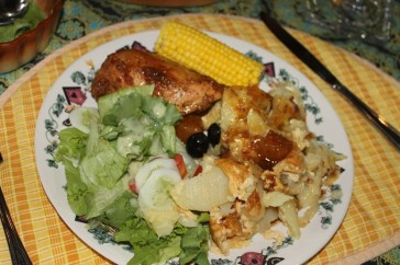 Pineapple chicken, scalloped potatoes, sweet corn and salad