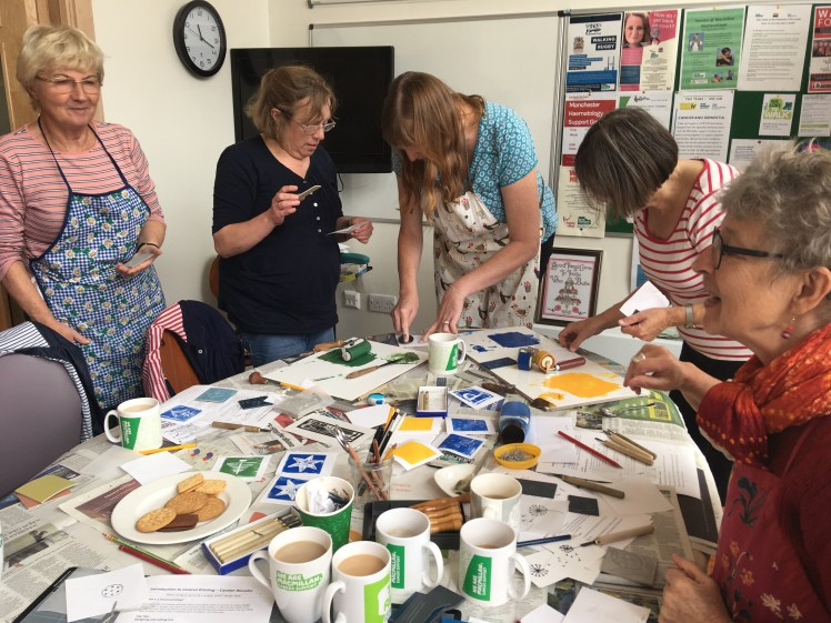 Image of Macmillan Craft Group printing linocuts