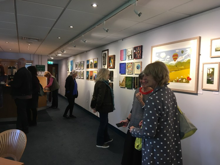 Image of visitors viewing the Northern Collective's work in the Circle Gallery