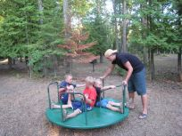 Taylor giving the little guys a ride at the playground