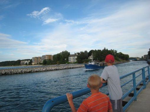 Zack and Luke watching boat go out to Lake Michigan