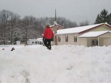 Josiah on top of the growing snow pile